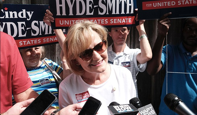 Republican U.S. Sen. Cindy Hyde-Smith answers questions from reporters at the Neshoba County Fair in Philadelphia, Miss., on Aug. 2, 2018. She became the first woman from Mississippi to serve in the U.S. Senate after Gov. Phil Bryant appointed her in April after former Sen. Thad Cochran retired due to health concerns.