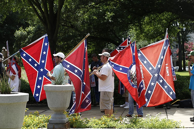 Some Mississippi residents are asking a federal court of appeals to fully consider their arguments that the state flag with the Confederate battle emblem represents white supremacy and sends a message that black people are not welcome.