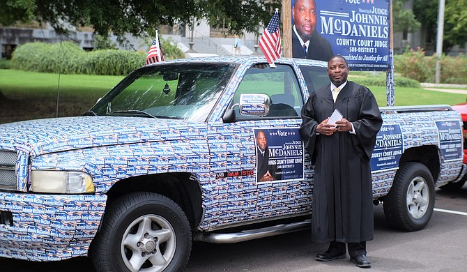 Johnnie McDaniels, executive director of Henley-Young Juvenile Justice Center, stuck 1,400 bumper stickers on his pick-up truck for the Hinds County judge race.