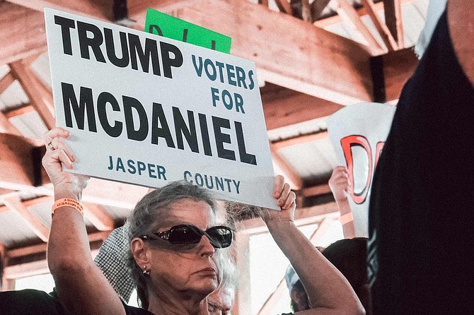 Trump voters at the Neshoba County fair held signs for Chris McDaniel. Trump endorsed his opponent, Cindy Hyde-Smith, via Twitter.