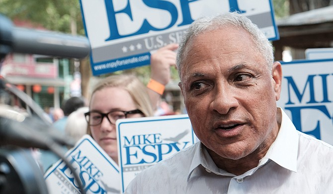 Democratic U.S. Sen. candidate Mike Espy—who is challenging incumbent Republican U.S. Sen. Cindy Hyde-Smith in a special election on Nov. 6—announced the opening of his campaign headquarters on Aug. 25, 2018. Seen here, Espy speaks to voters at the Neshoba County Fair on Aug. 2.