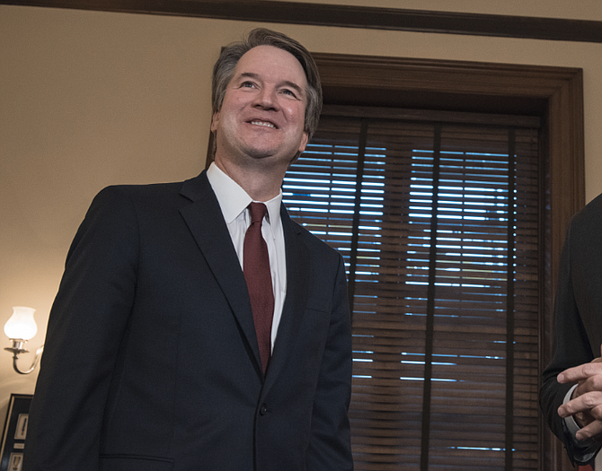 The tone of the 2003 email is different from Brett Kavanaugh's remarks stressing how difficult it is to overturn precedent like Roe during confirmation hearings, which opened for a third day Thursday with angry complaints and finger-pointing among senators over the unusual vetting process for the judge.