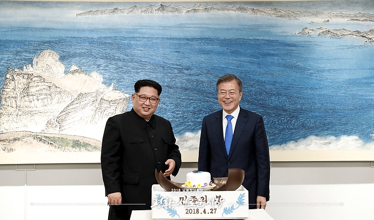 Moon Jae-in (right) faces increasing pressure from Washington to find a path forward in efforts to get Kim Jong Un (left) to completely—and unilaterally—abandon his nuclear arsenal, which is thought to be closing in on the ability to accurately target any part of the continental United States.