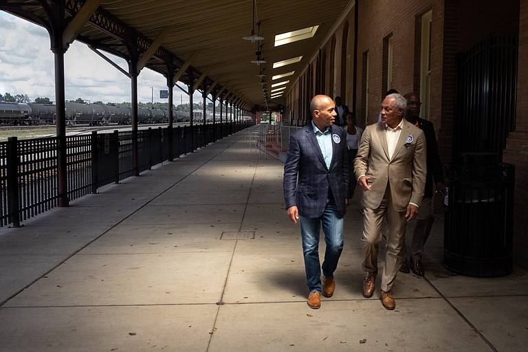 Former Massachusetts Gov. Deval Patrick speaks with Mike Espy, a Democrat running in Mississippi's U.S. Senate special election, at the train station in Hattiesburg, Miss., just after announcing his support on Sept. 22, 2018. Photo by Ashton Pittman