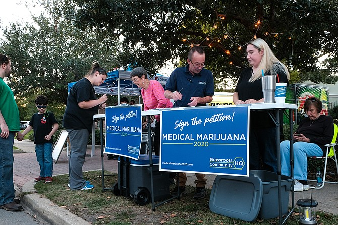 Petitioners gather signatures for the Medical Marijuana 2020 Ballot Initiative in Hattiesburg, Miss., on Oct. 12, 2018.