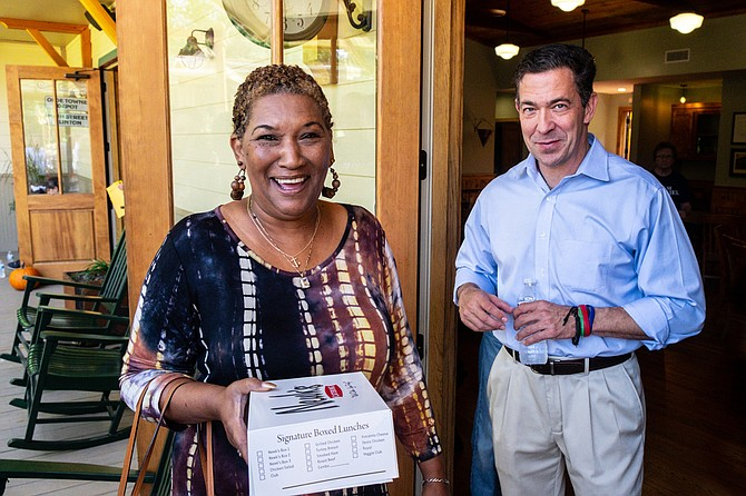 U.S. Senate candidate Chris McDaniel speaks with Wanda Evers, niece of slain civil-rights leader Medgar Evers, at a campaign event in Clinton, Miss., on Oct. 13, 2018.