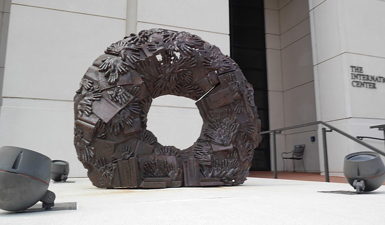 """""""Eudora Welty Wreath,"""" the iron sculpture that Tordella-Williams created for the exhibition, features castings of handprints from patrons of the Eudora Welty Library in Jackson, as well as cast-off books from a book sale at the library. Photo courtesy Millsaps College"""