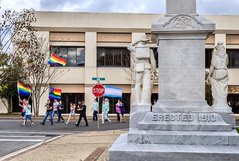 LGBT rights advocates mar ch past a Confederate monument on Main Street in Hattiesburg, Miss., at the third annual Southern Fried Pride on Nov. 18, 2017. Among major Mississippi cities in HRC's equality index, Hattiesburg is second after Jackson.