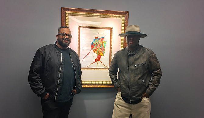 """(Left to right) Erin Davis and Vince Wilburn Jr., the youngest son and nephew of iconic trumpet-player Miles Davis, attended the opening reception for """"We're Miles Ahead: The Miles Davis Exhibition,"""" which is on display at Jackson State University's downtown campus through Nov. 30."""