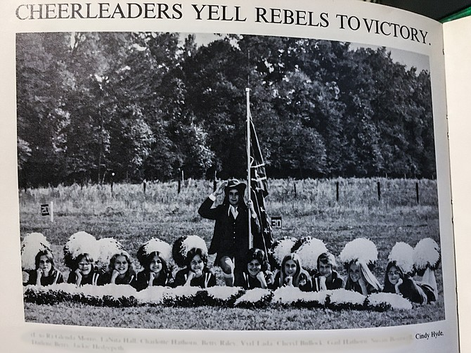 U.S. Sen. Cindy Hyde-Smith appears third from the right in a 1975 yearbook photo of cheerleaders at Lawrence County Academy. The mascot appears in the middle dressed as a Confederate colonel holding a rebel flag.