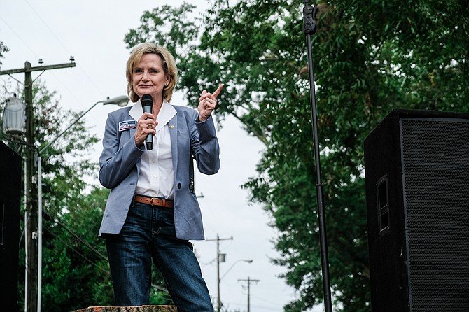"Republican U.S. Sen. Cindy Hyde-Smith returns to Washington as a solidly loyal supporter of President Donald Trump after he stumped for her in a divisive Mississippi runoff shaped by her video-recorded remark about ""public hanging."""
