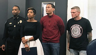 JPD Assistant Chief Ricky Robinson, criminal-justice advocate Rukia Lumumba, and reformed criminals Terun Moore and Benny Ivey wait in City Hall to explain Jackson's new credible-messenger strategy.