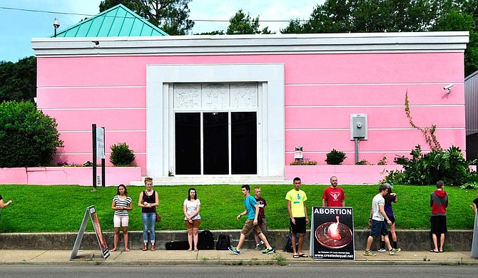 A lawsuit fighting Mississippi's 15-week abortion ban on behalf of Jackson Women's Health Organization, known as the Pink House, will move on to the 5th U.S. Circuit Court of Appeals. This photo is from a 2014 protest outside the clinic. Trip Burns/File Photo