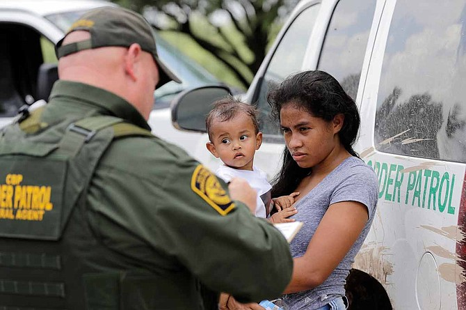 Two refugee children died in U.S. Border Patrol custody in December after the Trump administration made it increasingly difficult for refugee families seeking asylum to enter the country legally. Photo by David J. Phillip/AP