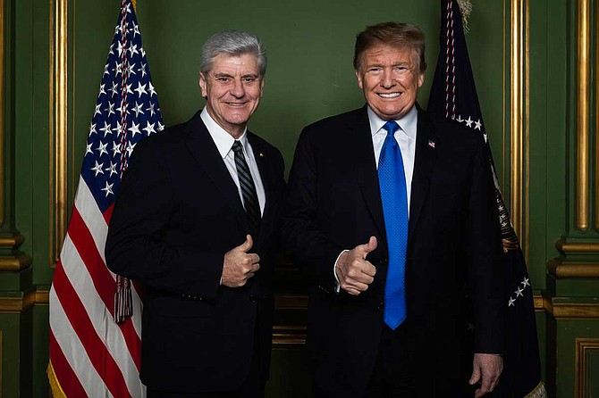 Gov. Phil Bryant poses for a photo with President Donald Trump at a meeting of the National Governors Association on Feb. 22, 2019. Photo courtesy Twitter/@PhilBryantMS