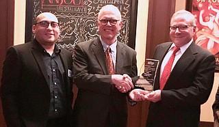 On Jan. 31, the Jackson chapter of technology organization CompTIA Association of Information Technology Professionals named Richard Sun (middle) as Mississippian of the Year. He says the award represents the collective achievement of everyone who is involved in the Mississippi Coding Academies. He is pictured with MSCA instructor Javier Peraza (left) and AITP President Bart Uharriet (right). Photo courtesy Mississippi Coding Academies