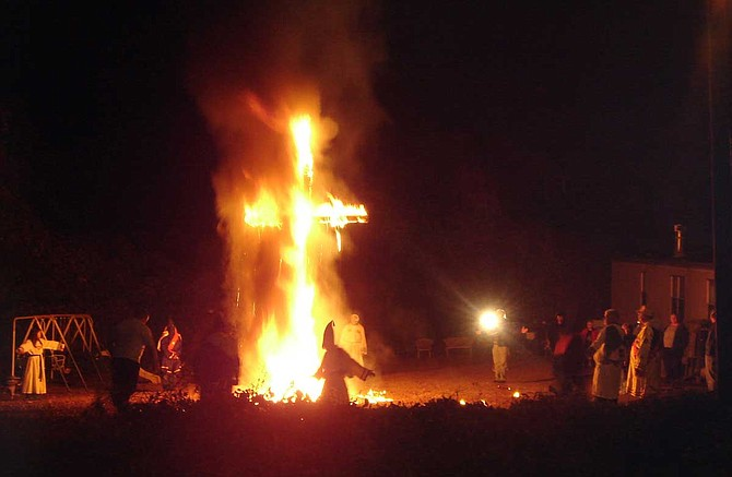 Cross burnings, like this one at an unidentified location in 2005, are less common than they were in the Jim Crow era, but remain staples of private Klu Klux Klan gatherings. People still sometimes use them to intimidate and harass African Americans. Photo courtesy Wikimedia Commons