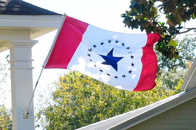 Laurin Stennis says her flag design represents unity. It has red vertical bars on each side and a white center with a large blue star encircled by 19 smaller ones, representing Mississippi as the 20th state. Photo courtesy Stennis Flag Flyers