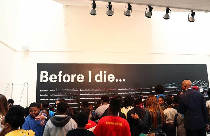 """The Greater Jackson Arts Council and Visit Jackson unveiled Jackson's """"Before I Die"""" wall, a project that artist and activist Candy Chang began in 2015."""