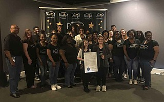 Jazz artist Pam Confer (center back) poses with choir members from Raymond Elementary School, Raymond High School and Terry High School, as Raymond Elementary School fifth-grader Trinity Spille (center) holds Gov. Phil Bryant's Mississippi Beautiful Day proclamation. Photo by Aliyah Veal
