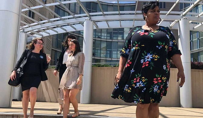 Jackson Women's Health Organization Director Shannon Brewer (right, front) leaves federal court in Jackson, joined by attorneys from the Center for Reproductive Rights, after a hearing on Mississippi's six-week abortion ban.