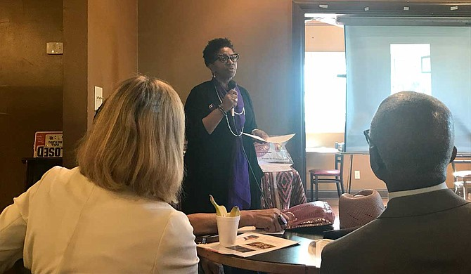 Willie Jones, president of Women for Progress, speaks to an audience at the Refill Cafe about dispeling voter apathy and reforming the voting process in Mississippi.