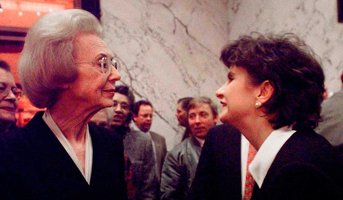 Former Lt. Gov. Evelyn Gandy greets Amy Tuck shortly after her 1999 election as lieutenant governor at a reception in the Mississippi State Capitol on Jan. 6, 2000. Tuck is one of just three women to hold statewide office since Gandy first broke the barrier in 1959. The third is current state Treasurer Lynn Fitch. Photo by Rogelio v Solis via AP