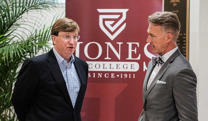 """Mississippi Lt. Gov. Tate Reeves speaks with Jones College President Jesse Smith (right) at the school's campus moments after unveiling a $100 million plan to """"modernize"""" Mississippi's workforce."""