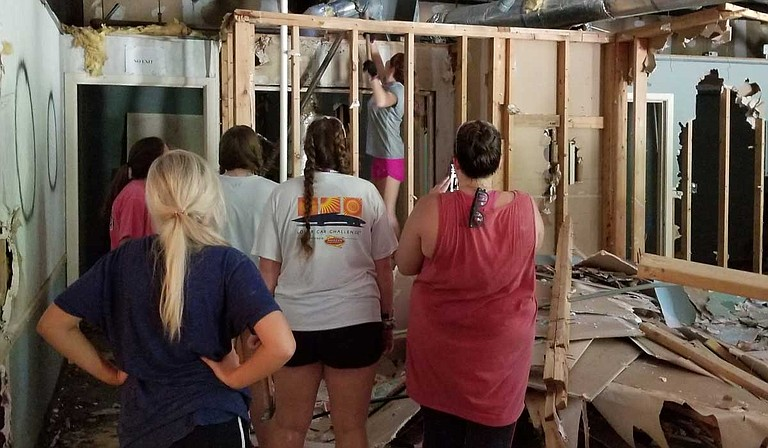 First Baptist Church of Fannin and Super Summer Serving mission groups help the Jackson Resource Center demolish a building in south Jackson to turn into a homeless resource center to help them get back on their feet. Photo by Putalamus White