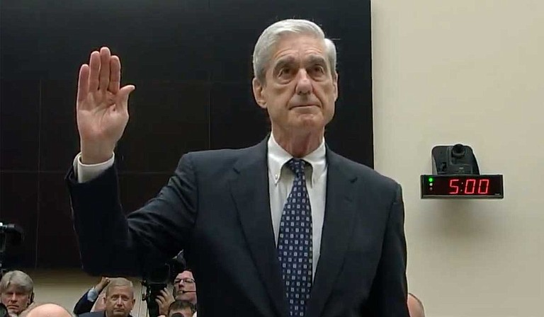Robert Mueller on Wednesday bluntly dismissed President Donald Trump's claims of total exoneration in the federal probe of Russia's 2016 election interference, telling Congress he explicitly did not clear the president of obstructing his investigation. Photo courtesy CSPAN