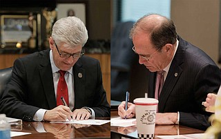 Gov. Phil Bryant (left) and Secretary of State Delbert Hosemann (right) asked in May that the court immediately overturn the district judge and re-instate the original lines. They had hoped for a ruling in time to reopen qualifying for the primary. Photo by Imani Khayyam