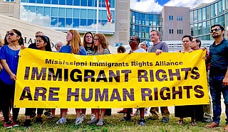 Immigrants' rights activists protest against the Trump administration's decision to open detention facilities in Mississippi outside the U.S. District Court building in Jackson on July 12, 2019. Photo by Ashton Pittman