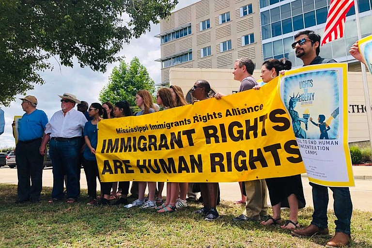 A group of immigrants' rights activists protested against the Trump administration's decision to open detention facilities in Mississippi outside the U.S. District Court building in Jackson last month. Photo by Ashton Pittman