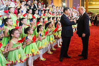 President Donald J. Trump and First Lady Melania Trump, joined by President Xi Jinping and First Lady Peng Liyuan, applaud and thank the performers at a cultural performance at the Great Hall of the People, Thursday, November 9, 2017, following a State Dinner in their honor, in Beijing, People's Republic of China. Official White House Photo by Andrea Hanks