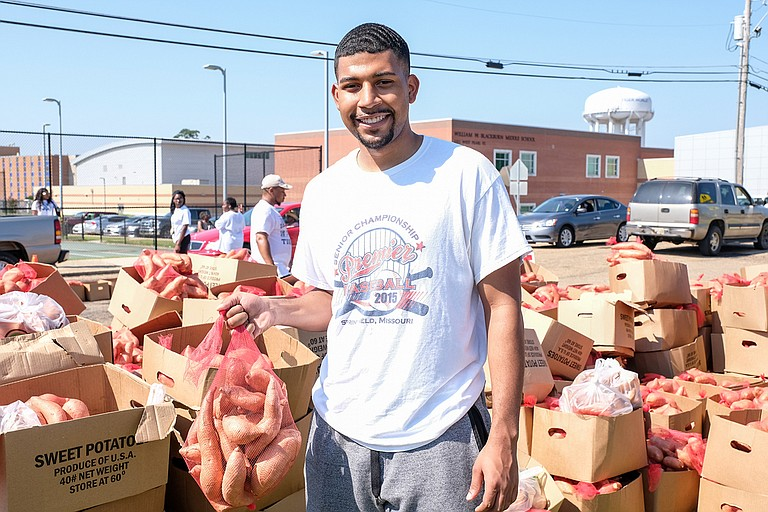 The Crop Drop, an annual event hosted by Jackson State University and the Society of St. Andrew, donated 25,000 pounds of sweet potatoes and other goods to the community on Saturday. Grant Broadway, a senior and Mister JSU 2019, poses for a photo at the event. Photo by Charles A. Smith/JSU