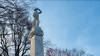 Sparks agreed in March to calls from faculty, students and staff to move the marble soldier and base from near the school's historic heart. The monument has stood sentry there since 1906, when the United Daughters of the Confederacy commissioned it. Photo by Brian Powers