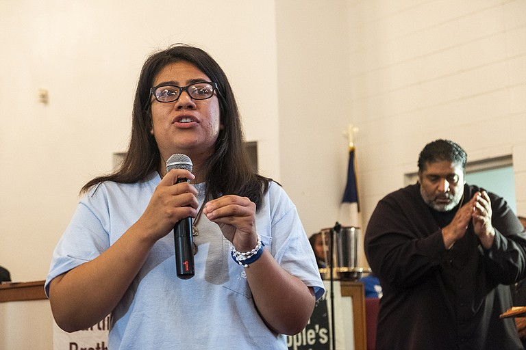 Daisey Martinez, left, a community organizer working to help families the recent Mississippi ICE raids targeted, delivers her testimony alongside Rev. Dr. William J. Barber II (right) at a mass meeting at the Liberty Missionary Baptist Church in Canton, Miss., on Aug. 29, 2019. Photo by Seyma Bayram