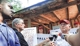 Media gathered around Bill Waller Jr. at the Neshoba County Fair in August 2019. But the meaningful substance of his platform seldom broke through. Photo by Ashton Pittman