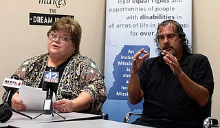Disability Rights Mississippi Executive Director Polly Tribble (left) and sign-language translator Greg Goldman (right) address reporters during a press conference at her office in Jackson on Sept. 5, 2019. Tribble responded to U.S. District Court Judge Carlton W. Reeves' ruling that Mississippi is violating the civil rights of residents with mental-health issues. Photo by Seyma Bayram.