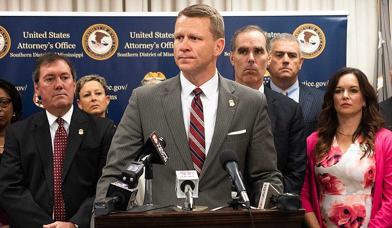 United States Attorney D. Michael Hurst Jr. (center) announces the launch of a new statewide Mississippi Human Trafficking Council from his office in the Thad Cochran Federal Courthouse in Jackson, Miss., on Sept. 10, 2019. Photo by Seyma Bayram
