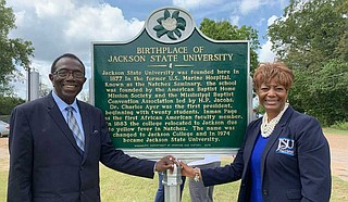 Alumnus and JSU professor Dr. Hilliard Lackey (left) poses beside the JSU historical marker in Natchez with JSUNAA President, Dr. Earlexia Norwood (right). Photo courtesy JSU
