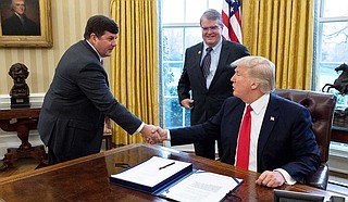 U.S. Rep. Steven Palazzo, R-Miss., left, shakes hands with President Donald Trump during a Spring 2019 meeting in the Oval Office.