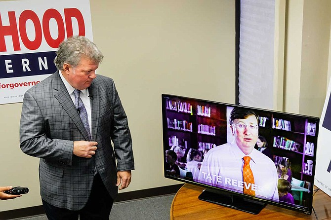 "Mississippi Attorney General Jim Hood, the Democratic nominee for governor, watches while an aid plays an education ad from Republican opponent Tate Reeves that Hood calls ""fraudulent."" Photo by Ashton Pittman."