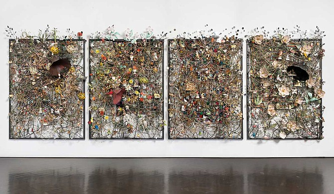 """Nick Cave: Feat."" debuted at Frist Art Museum in Nashville, Tenn., in 2017. The exhibit includes 17 works, including 10 of Cave's signature ""soundsuits,"" which are wearable sculptures made from repurposed everyday objects. Photo courtesy James Prinz Photography"
