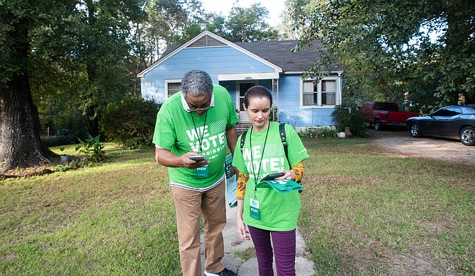 """We Vote! Mississippi"" canvassers last week going door-to-door to let Mississippians know the stakes of Nov. 5. Photo by Roy Adkins."