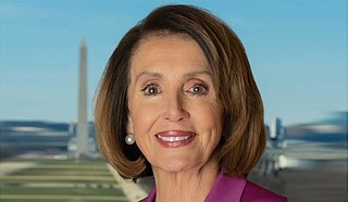 """""""What is at stake in all this is nothing less than our democracy,"""" said House Speaker Nancy Pelosi, D-Calif. Underscoring her point, she addressed the House with a poster of the American flag beside her and began her remarks by reading the opening lines of the preamble to the Constitution. Photo courtesy U.S. Congress"""