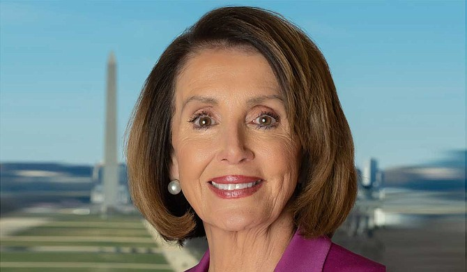 """What is at stake in all this is nothing less than our democracy,"" said House Speaker Nancy Pelosi, D-Calif. Underscoring her point, she addressed the House with a poster of the American flag beside her and began her remarks by reading the opening lines of the preamble to the Constitution. Photo courtesy U.S. Congress"