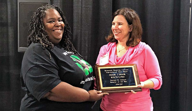 Faith Young (left) with a representative of the Mississippi Recycling Coalition Photo courtesy Faith Young