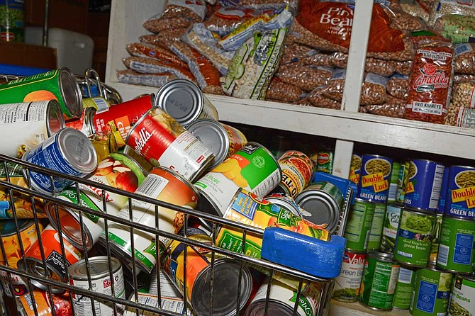The Stewpot food pantry serves more than 5,000 people per year, half of which are senior citizens age 65 or over, Buckley says. Stewpot also provides guests with travel bags of items that don't need heating, including canned food, dried fruit and other items. File Photo by Trip Burns