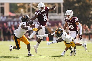 MSU running back, Kylin Hill rushes for the Bulldogs. Courtesy of MSU Athletics.